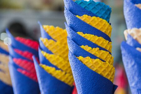 colorful waffle cones and blue paper napkins.