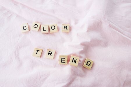 the words color trend is written in cubic letters on a pink color textile background, selective focus. 写真素材