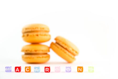 Macaroons with colorful cube letters on white background top, color macaroons, selective focus. 版權商用圖片