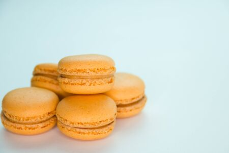 Macaroons on white background top, colorful yellow macaroons, selective focus.