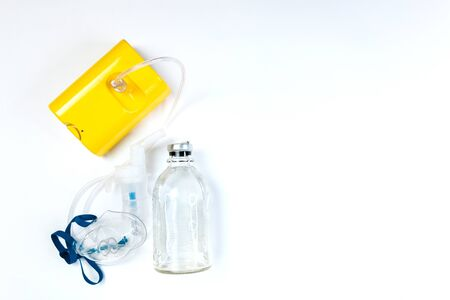tube mask nebulizer and tubular transparent cable, saline on a white background, inhalation. Foto de archivo