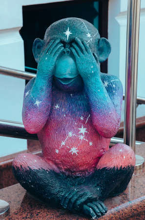 Street photo of a figure of a bright multicolored monkey with closed eyes of unusual color depicts various emotions. Moscow. Russia. June 2020. 新聞圖片