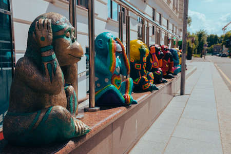 Street photography of brightly colored monkey figures depicts various emotions. Moscow. Russia. June 2020