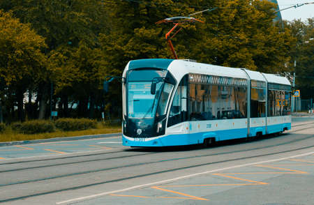Modern public transport the blue tram follows its own route. Moscow, Russia, June 2020. 版權商用圖片 - 149225481
