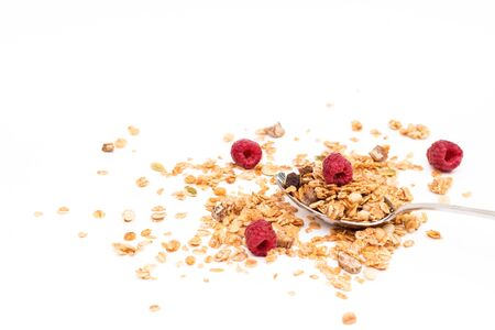 Crispy muesli with raspberry dry Breakfast isolated on white background selective focus, top view. 版權商用圖片 - 150221734