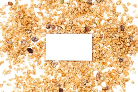Crispy muesli dry Breakfast and blank sheet of writing paper isolated on white background selective focus, top view.