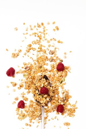 Crispy muesli with raspberry dry Breakfast isolated on white background selective focus, top view. 版權商用圖片