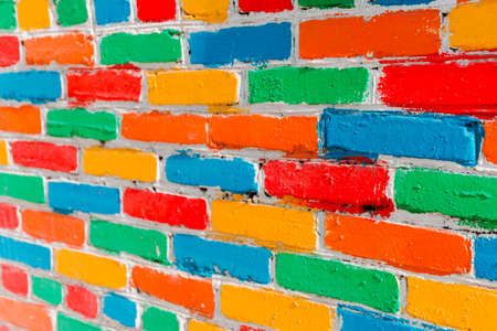 bright colorful multi-colored painted brick texture background, selective focus.