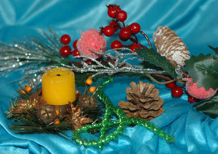 Christmas background. Pine branches, toys, candle on a blue background Stock Photo