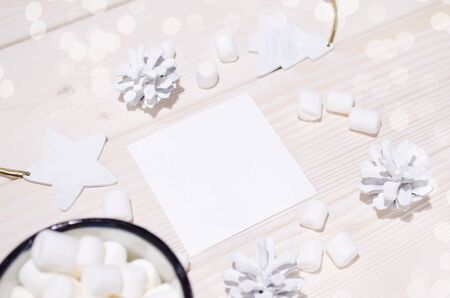 Christmas composition. Photo mockup with white decorations on white wood background. Christmas, winter, new year concept.