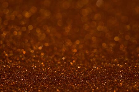 Abstract Christmast red heart bokeh background with shining defocus sparkles. Blurred glitters shimmering dust macro close up, copy space for text logo. De-focused