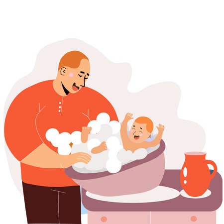dad on maternity leave bathes the child in the tub, the happiness of fatherhood