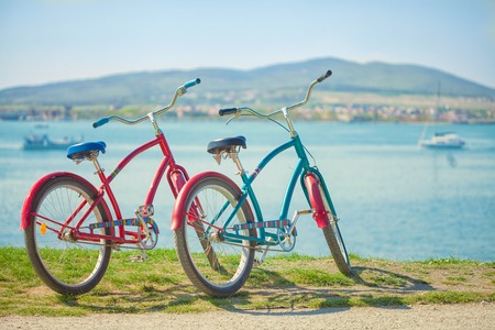 Two bright bicycles on the background of the sea. Stock Photo