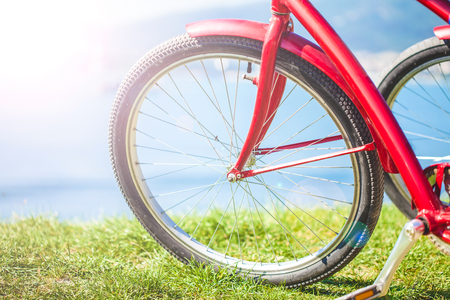 Wheel of a bicycle on a background of the sea close up. Stock Photo