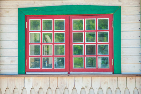 Image of vintage red window on a white wooden wall Stockfoto