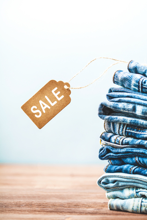 Concept sales, blue jeans on a light background Close up Sale sings Stock Photo