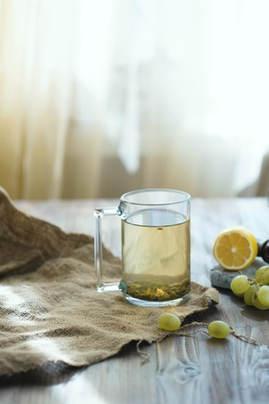 A mug of tea with lemon on the table. Morning concept Stok Fotoğraf