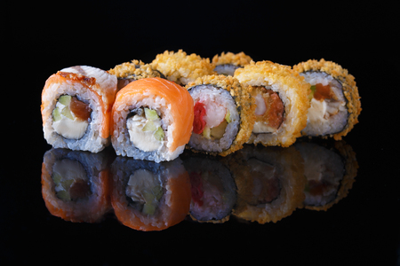 delicious set of sushi roll with fish on a black background with reflection Menu and restaurant concept Copy space Reklamní fotografie