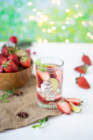 healthy refreshing energy ice cold strawberries lemonade with lime on bright summer background Stock Photo
