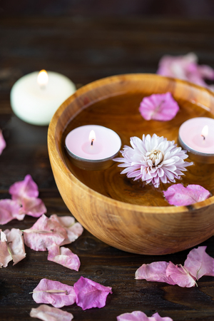 Aroma candles, aroma sticks, rose water, flower petals. Items for aromatherapy, massage. Relax and spa theme