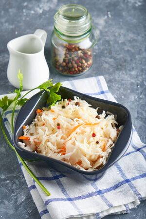 Homemade Sauerkraut with seasonings in an gray bowl. Natural Probiotics, Healthy Food