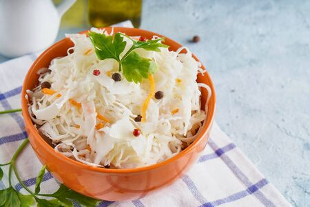 Sauerkraut with spices in an orange bowl. Natural Probiotics, Healthy Food Copy space