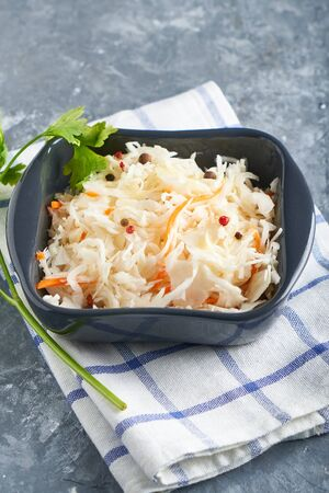 Sauerkraut with seasonings in dark bowl. Natural Probiotics, Healthy Food Vertical