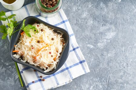 Homemade Sauerkraut with seasonings in an gray bowl. Natural Probiotics, Healthy Food Copy space