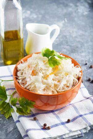 Homemade Sauerkraut with seasonings in an orange bowl. Natural Probiotics, Healthy Food Vertical