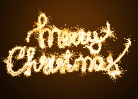 Inscription Merry Christmas from Bengal lights. New Years and Christmas concept 스톡 콘텐츠