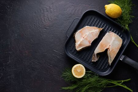 fresh fillet of sea fish in a grill pan Copy space On dark background 스톡 콘텐츠