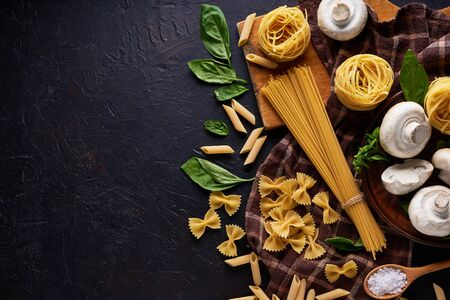 ingredients for cooking traditional pasta with mushrooms on dark stone background Top view Copy space Stock fotó - 133400893