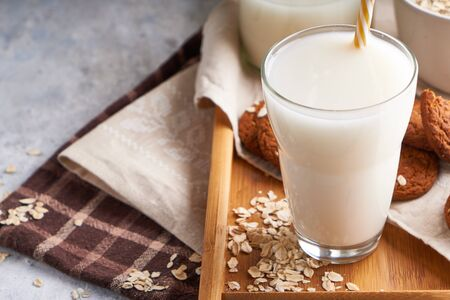 Healthy alternative milk. Homemade oak milk in glass and bottle on light table Lactose free Close up 스톡 콘텐츠