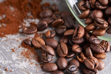 Close up coffee beans in a glass jar on gray stone table Horizontal 스톡 콘텐츠