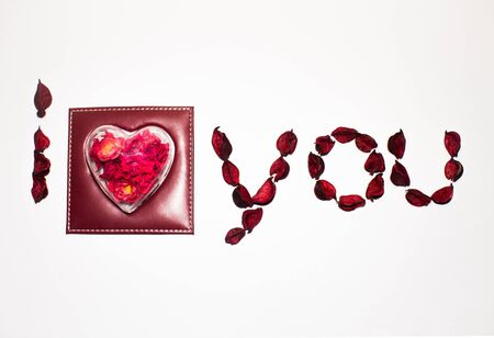 I love you lined with dried flowers and heart on white background Stock Photo