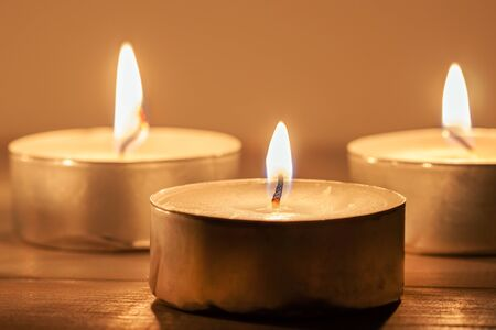 Three light candles with fire meditative relaxing macro wallpaper