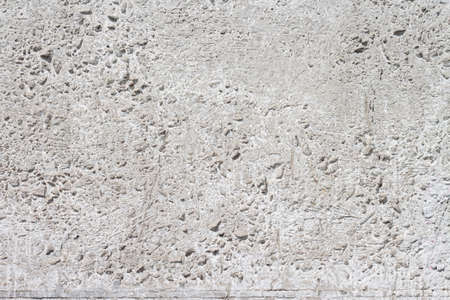 Concrete with rocks wall bumpy surface cool urban grungy wallpaper macro