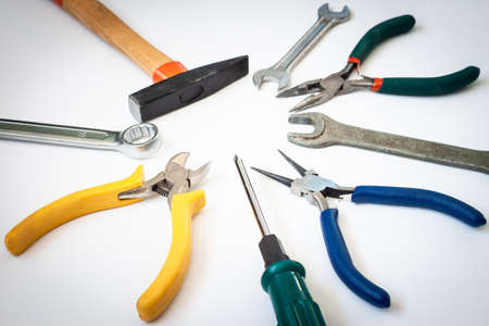 Set of different tools hammer, pliers, screwdriver, wrenches isolated on white background