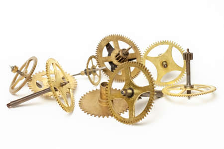 Several steampunk golden copper bronze different mechanic retro steel parts cogwheels isolated on white background macro