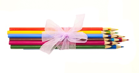 sharpened colored pencils, tied with pink ribbon Stock Photo
