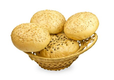 wheat bun with sesame seeds in a basket on a white background Stock Photo - 13706354