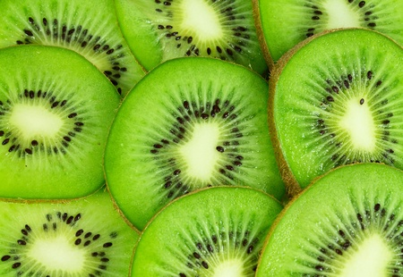 exotic fruit sweet juicy ripe kiwi background Stock Photo