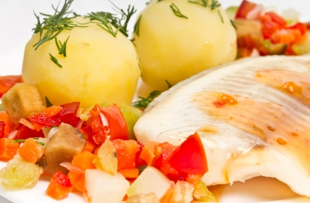 fish fillet with steamed vegetables and potatoes Standard-Bild