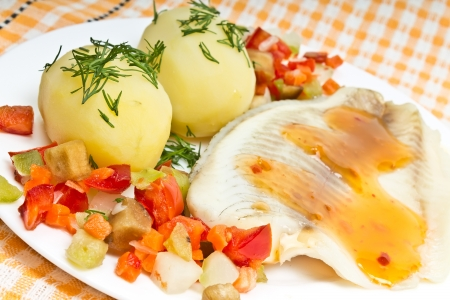 fish fillets, dill potatoes and steamed vegetables  photo