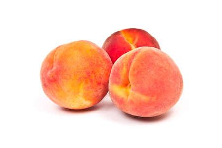 three juicy sweet peach isolated on white background photo