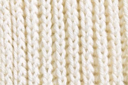 wool fiber: la textura de la trenza de lana de punto blanco