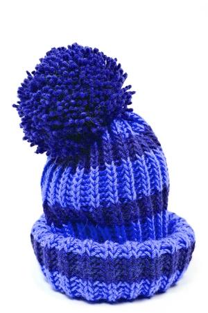 白い背景で隔離青いニット ウールの帽子 写真素材