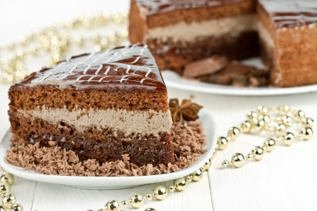 piece of chocolate cake, star anise and Christmas Beads
