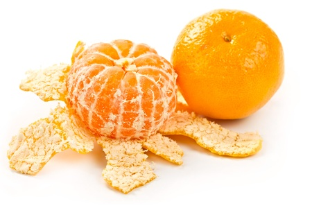 a tangerine and mandarin peeled isolated on white background Standard-Bild