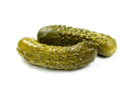Two marinated pickled cucumbers isolated on white background